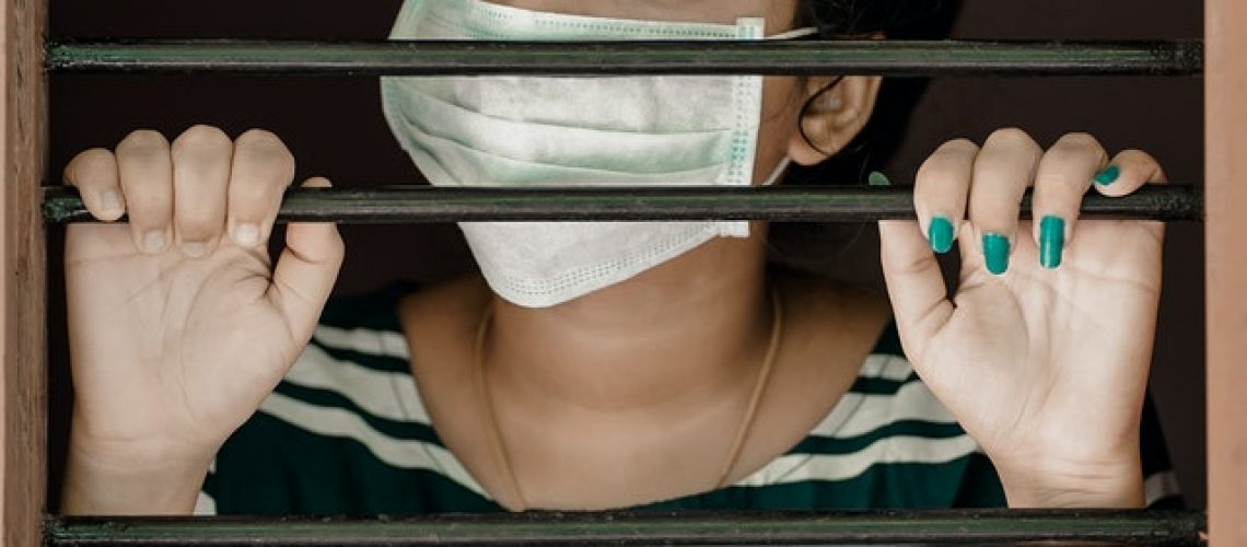 woman-in-green-and-white-stripe-shirt-covering-her-face-with-3991311.jpg